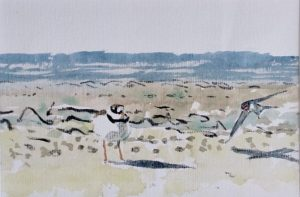 standing Ringed Plover on shoreline with flying swallow by John Busby
